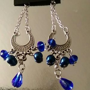 Hanging horse shoe earrings blue crystal
